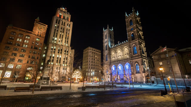 timelapse view of montreal city near the notre dame cathedral by night in winter - montréal stock videos & royalty-free footage