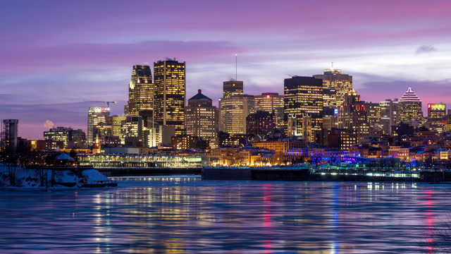 timelapse view of montreal city skyline and river by night in winter - montréal stock videos & royalty-free footage