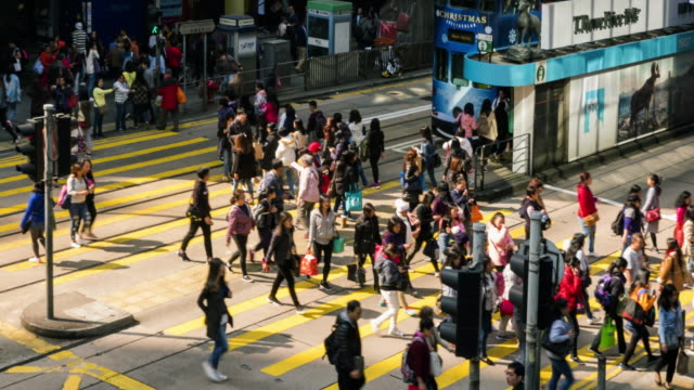 4K Timelapse view of people at a crossing on the streets of Causeway Bay in Hong Kong. Hong Kong is a major financial hub in the Asia region.