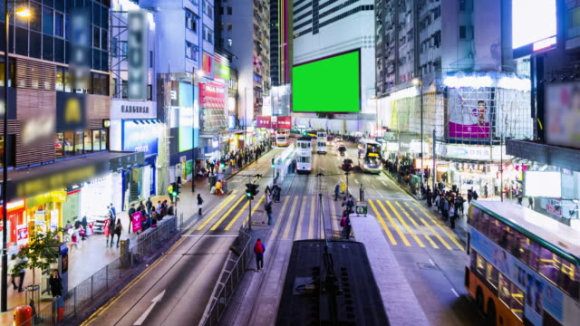 4k timelapse : view of people on the streets hong kong city at causeway bay in hong kong is a major financial hub in the asia region and green scene.zoomin styles. - bus billboard stock videos & royalty-free footage