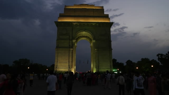 A time-lapse view of the crowd at the war memorial of India Gate in the evening at Rajpath, New Delhi
