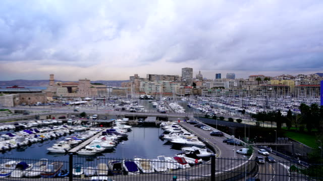time-lapse :view of the vieux port (old port) in marseille at twilight - notre dame de la garde marseille stock videos and b-roll footage