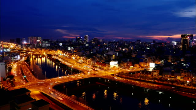 timelapse view over ho chi minh city transitioning between sunrise and night at vo van kiet avenue - ho chi minh city stock videos & royalty-free footage