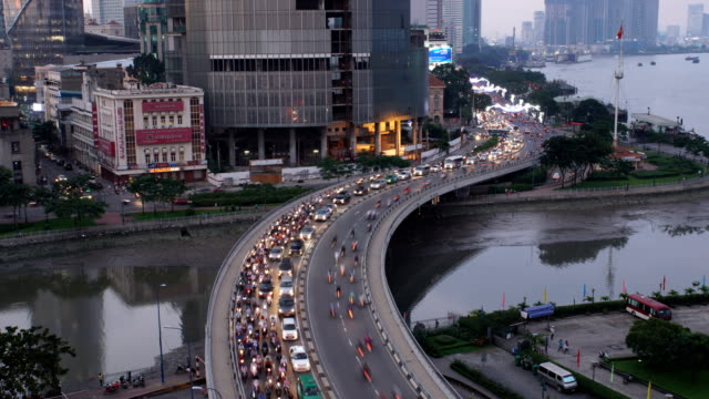 timelapse view over ho chi minh city with traffic at khanh hoi bridge - ho chi minh city stock videos & royalty-free footage