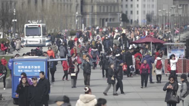 Timelapse visitors walk along the Bund in Shanghai China on Tuesday Jan 31 2017