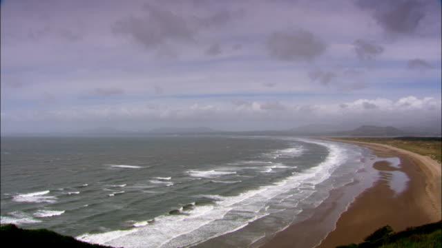 Timelapse waves lap onto beach, UK