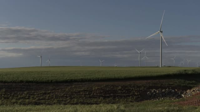 timelapse wide shot clouds move above wind turbines at the hornsdale wind farm operated by neoen sas near jamestown south australia on friday sept 29... - jamestown stock-videos und b-roll-filmmaterial