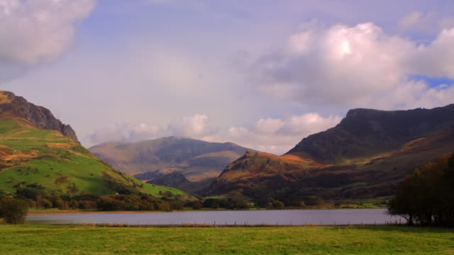time-lapse wide shot of snowdon with rolling clouds and nantlle in foreground - snowdonia stock videos & royalty-free footage