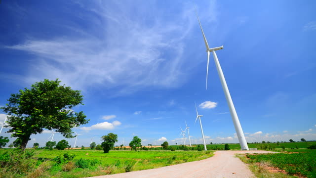 time-lapse: wind turbines with windy sky and cloudscape - full hd format stock videos & royalty-free footage