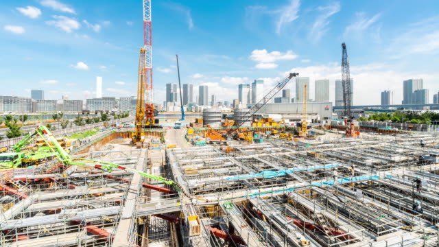 time-lapse: working at construction site in tokyo japan - construction frame stock videos & royalty-free footage