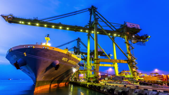 4k time-lapse: working at singapore shipyard port terminal morning twilight - construction machinery stock videos and b-roll footage