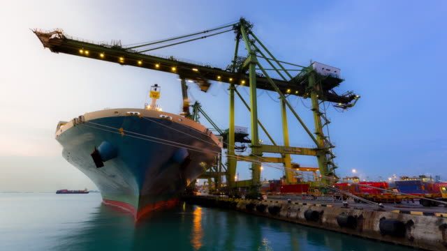 time-lapse: working at singapore shipyard port terminal morning twilight - loading stock videos & royalty-free footage