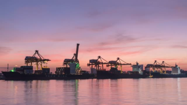 time-lapse: working at trading port terminal with container ship - sea channel stock videos & royalty-free footage