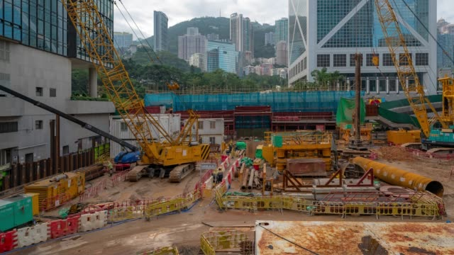 time-lapse: working in construction site in central hong kong - building activity stock videos & royalty-free footage
