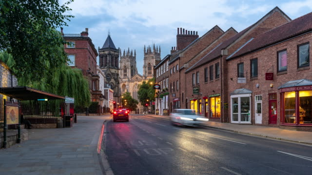 time-lapse: york minster cathedral sunset dusk, york, england uk. - yorkshire stock videos & royalty-free footage