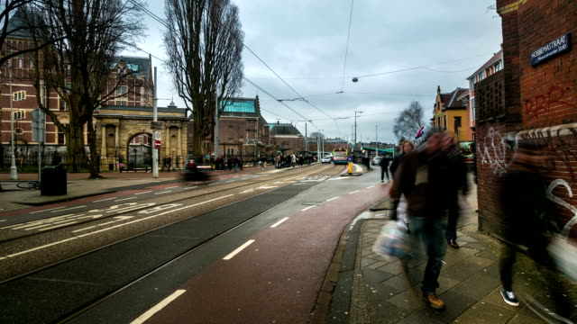 hd time-lapse zoom: city pedestrian and traffic in amsterdam garden - zoom stock videos and b-roll footage