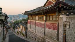 Timelapse zoom in shot of sunrise scene over Bukchon Hanok Village at Seoul city, South Korea