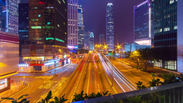 timelapse zoom in: traffic at central district in hong kong - zoom in stock videos & royalty-free footage