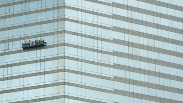 timelapse zoom out of window washer working - window washer stock videos & royalty-free footage