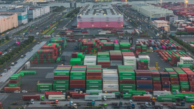 4k time-lapse: zoom out shipyard port terminal on working cargo container in port of odaiba tokyo japan - trailer stock videos & royalty-free footage
