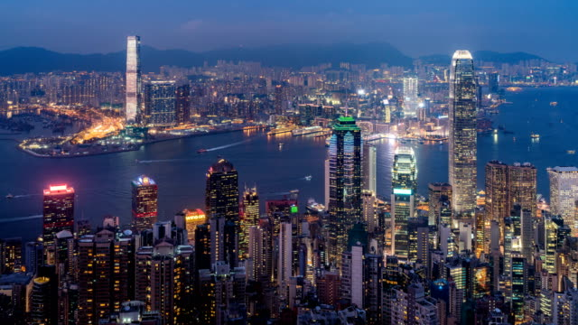 timelapse zoom out shot of hong kong cityscape taken from victoria peak travel destination - victoria peak stock videos & royalty-free footage