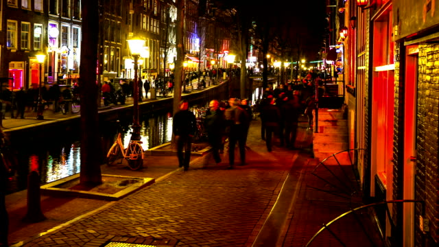 HD Time-lapse Zoom out: Tourist Amsterdam Red Light District night