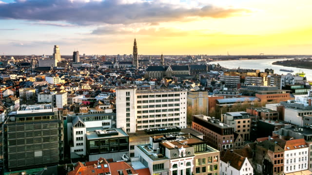 HD time-lapse zoom-out: Aerial Antwerp ancient town Belgium sunset