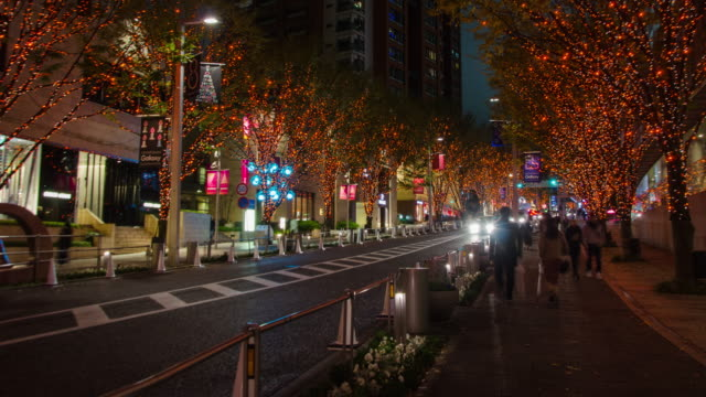 4k time-lapse zoomout :keyakizaka street at roppongi in tokyo , japan - roppongi stock videos and b-roll footage