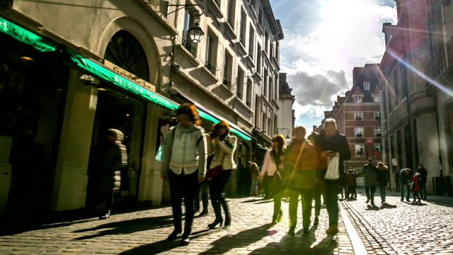HD Time-lapse zoom-out: Pedestrian at shopping street grand place Brussels
