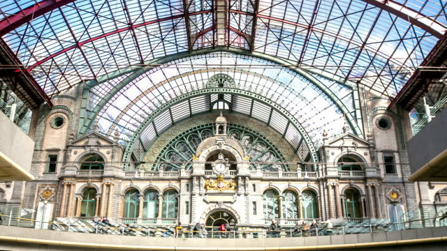HD time-lapse zoom-out: Tourist pedestrian travelling at Antwerp Central Station Belgium