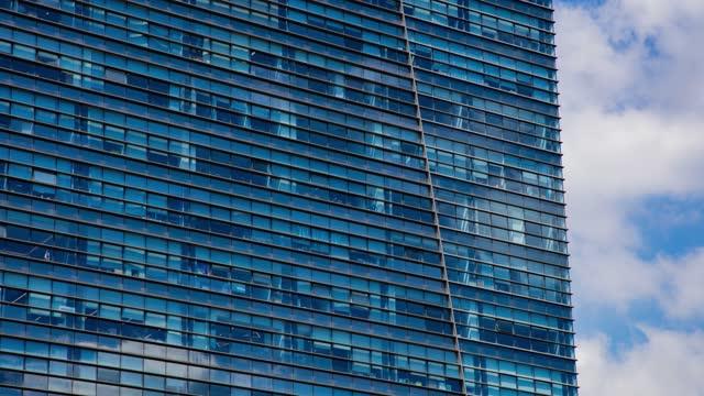 time-lapse,close up of building windows - fönsterrad bildbanksvideor och videomaterial från bakom kulisserna