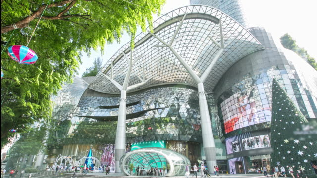 4k time-lapsed front of ion orchard shopping mall in singapore orchard road. - orchard stock videos & royalty-free footage