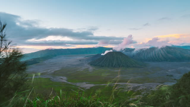4k time-lapsed of sunrise at mount bromo volcano, the magnificent view of mt. bromo located in bromo tengger semeru national park, east java, indonesia. - bromo tengger semeru national park stock videos & royalty-free footage