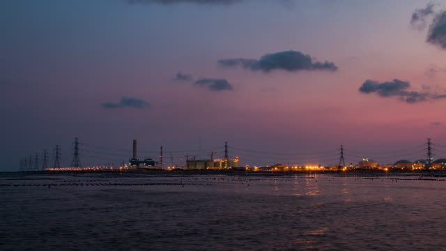 timelapse:high voltage post and industry zone offshore in twilight time - generator stock videos and b-roll footage