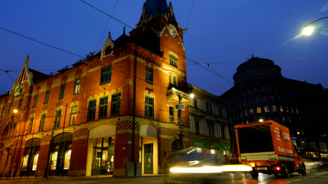 time-lapse:krakow, poland city street with tram - trolley bus stock videos & royalty-free footage