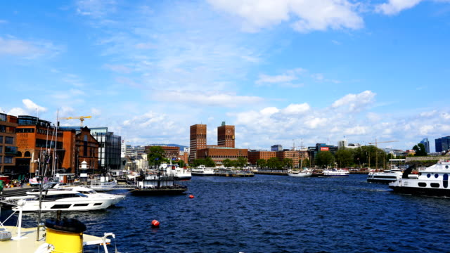 time-lapse:oslo city hall view form the oslo fjord water. - mayor stock videos & royalty-free footage