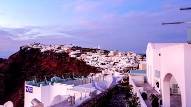 time-lapse:santorini sunset at dawn village of oia greece - oia santorini stock videos & royalty-free footage