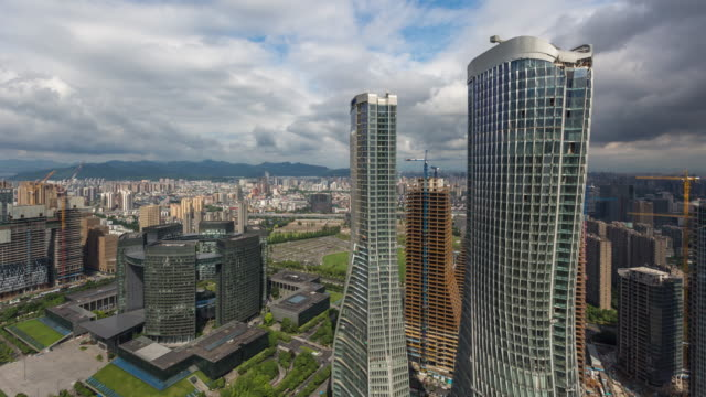 4k time-lapse:skyscrapers of downtown cbd against stormy clouds,hangzhou,china - raffles city stock videos & royalty-free footage