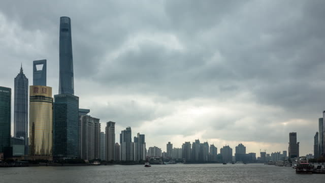 4k time-lapse:storm clouds over shanghai skyline at dawn - river huangpu stock videos & royalty-free footage