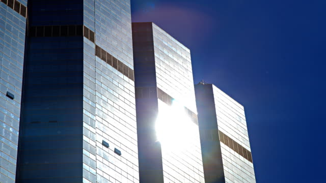 HD Timelapse:Sunlight reflective glass of a skyscraper.(zoom in)