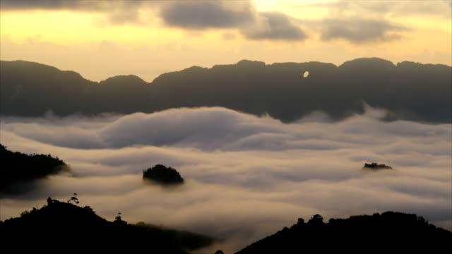 time-lapse.sunrise  moving fog on the mountain. - monsoon stock videos and b-roll footage