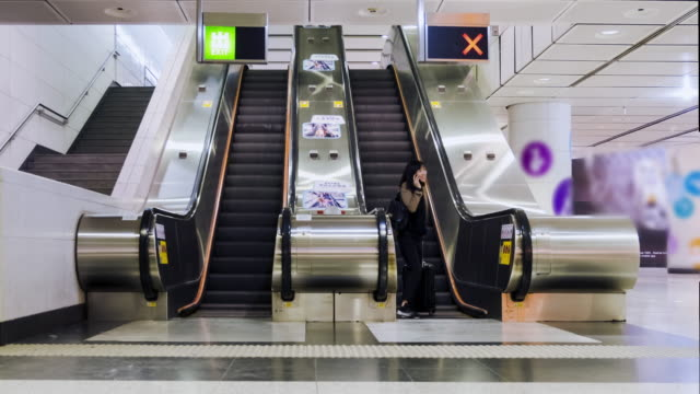 4K Timelapse:The escalator and passenger in subway at Hong Kong.