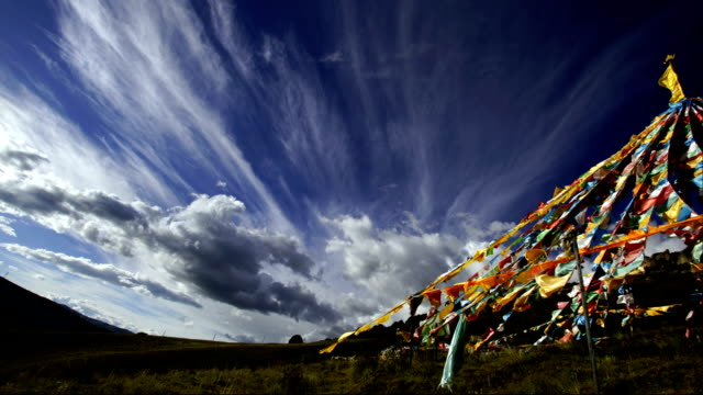 time-lapse:tibetan prayer flags at  lin zhi, china - tibet stock videos & royalty-free footage