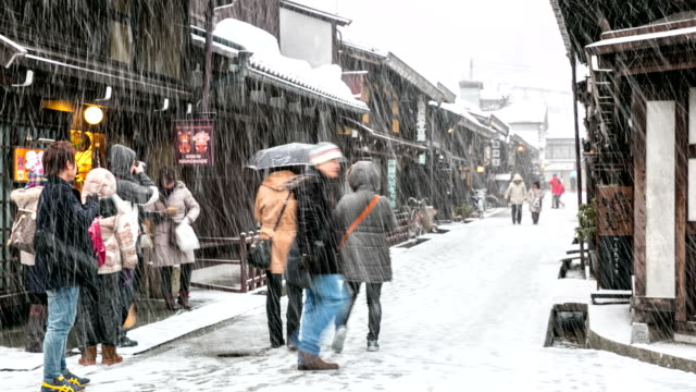 HD Time-lapse:Tourist Crowd in Takayama with snowfall