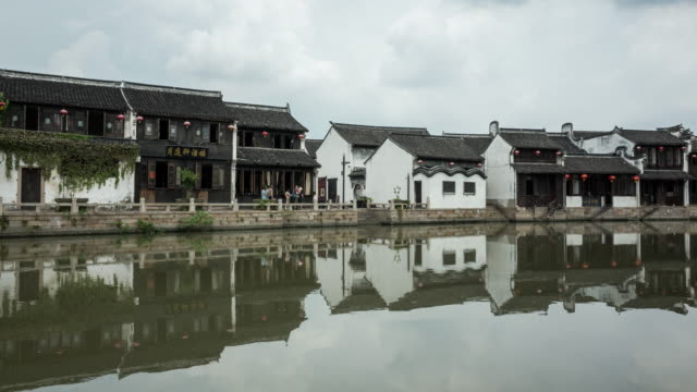 4K Time-lapse:Traditional houses and its reflection along the Grand Canal, ancient town of Yuehe in Jiaxing, Zhejiang Province,China