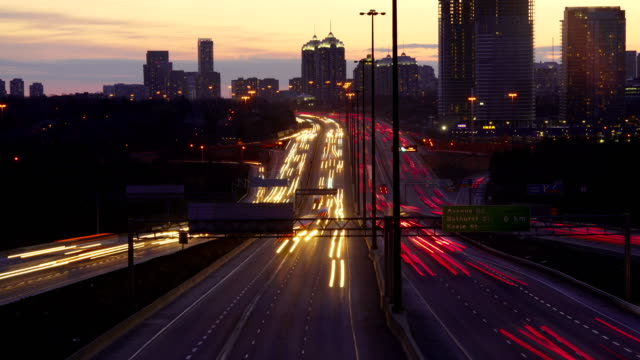 time-lapse:traffic at night,toronto - tail light stock videos & royalty-free footage