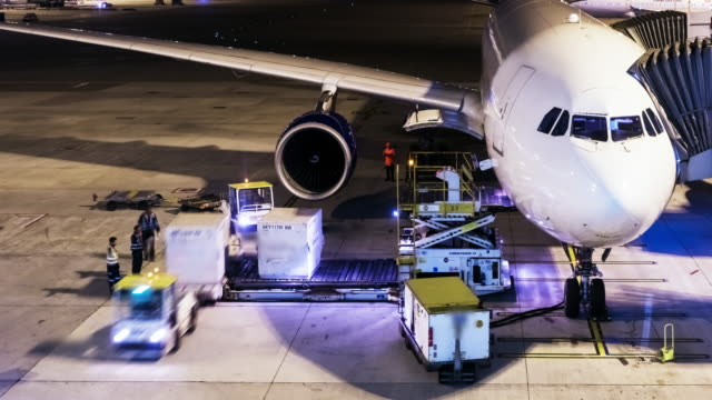 4k timelapse:unload cargo for air freight logistic in hong kong. - commercial airplane stock videos & royalty-free footage