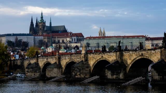 time-lapse:vltava river and charles bridge in prague - river vltava stock videos & royalty-free footage
