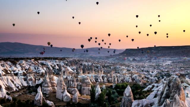 hd timelaps-hot air balloons in morning at cappadocia - cappadocia stock videos and b-roll footage