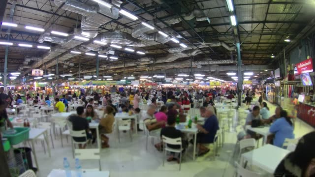 timelaspe : people eating in food center - food court stock videos and b-roll footage